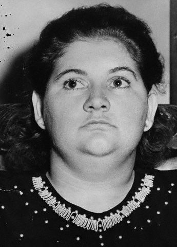 """Original Caption: Lovelorn Preying Couple Face New York Trial. Grand Rapids, Michigan: Mrs. Martha Beck (left) and her partner in crime, Raymond Fernandez bear the same deadpan expressions they have maintained throughout questioning on the """"lonely hearts' slayings of a suburban Grand Rapids widow and her daughter and the bludgeon-strangling murder of a New York widow. Mrs. Beck and Fernandez are to lose the sanctuary of Michigan where there is no capital punishment, to face death in New York in the electric chair. According to Nassau County district attorney Gehrig, he will start extradition proceedings to bring the couple to New York to stand trial for the slaying of Mrs. Janet Fay, Albany widow, in Valley Stream, L.I, on January 4."""