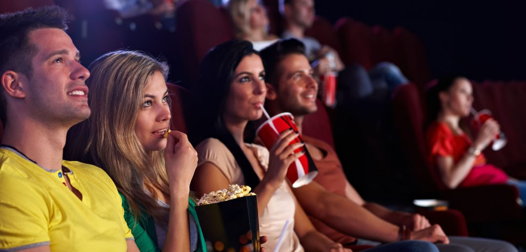 Movie-Young-people-sitting-in-multip-465638981