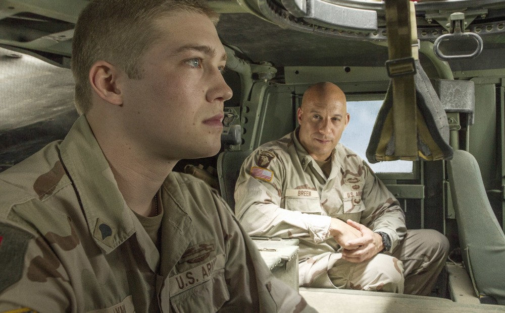 Billy Lynn ( Joe Alwyn) talks to Shroom (Vin Diesel) in TriStar Pictures' BILLY LYNN'S LONG HALFTIME WALK.